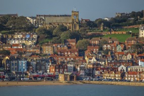 One of five photos on here, which can be stitched together to provide a very wide high resolution photo of the whole of the Bottom End of Scarborough, UK, behind the south beach. Potentially, you could, with these five photos, make a wall hanging some 15 feet wide x 2 feet high.