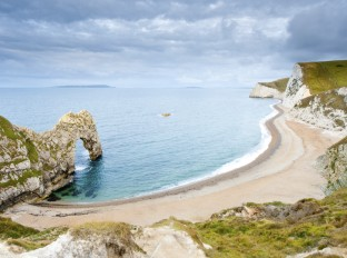 The curved bay at Durdle Door on the Jurassic Coast in Dorset, UK.