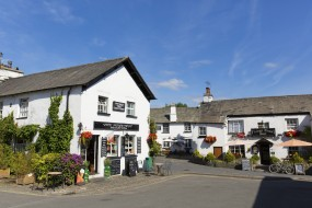 Hawkshead, England - July 10, 2014: The beautiful summer weather spell continues in the English Lake District at the popular tourist destination of Hawkshead